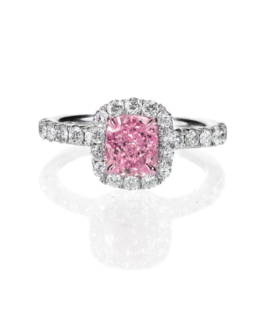 Pink diamond halo engagement wedding ring isolated on white