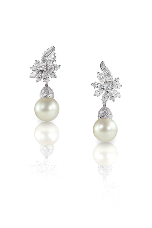 marquise: Beautiful Diamond pearl Marquise drop dangle earrings studs pair isolated on white with a reflection Stock Photo