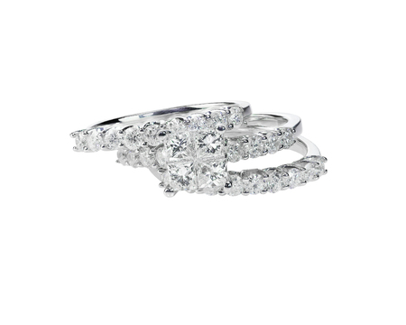 Diamond solitaire engagment wedding ring set isolated on white