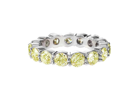 canary yellow diamond wedding band citrine ring isolated on white Stock Photo
