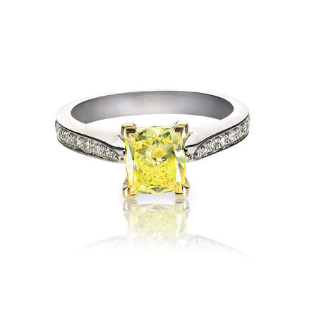 yellow diamond colored engagement ring isolated on white Stock Photo