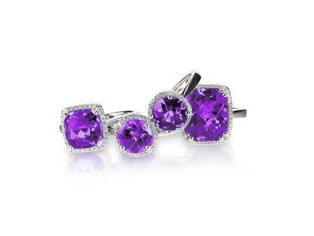 Set of purple amethyst ametrine rings gemstone fine jewelry. Group stack or cluster of multiple gemstone diamond rings.