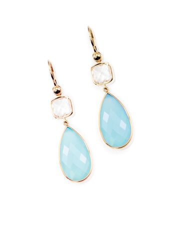 Blue teardrop and crystal dangle set of earrings isolated on white with a reflection
