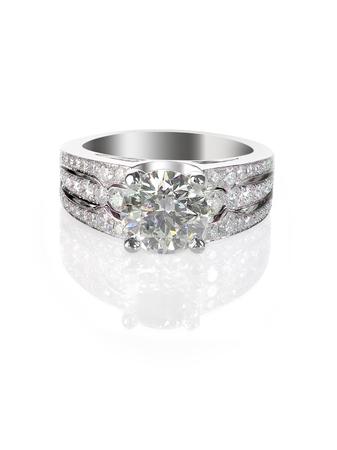Large white brilliant sparkling diamond wedding or engagment ring set on a white background 版權商用圖片