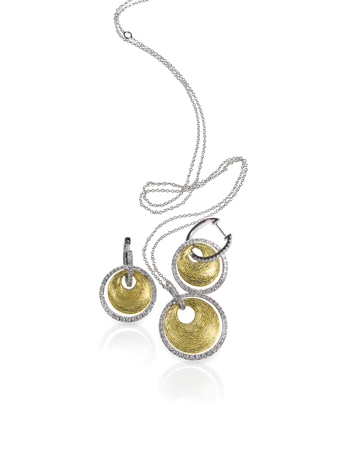 Diamond white and yellow gold fashion necklace and earrings set isolated on white with a reflection