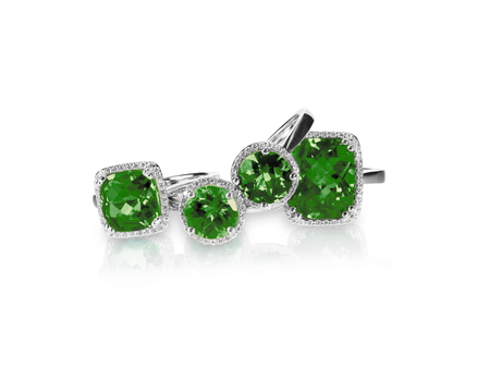 Set of green emerald rings gemstone fine jewelry. Group stack or cluster of multiple gemstone diamond rings.