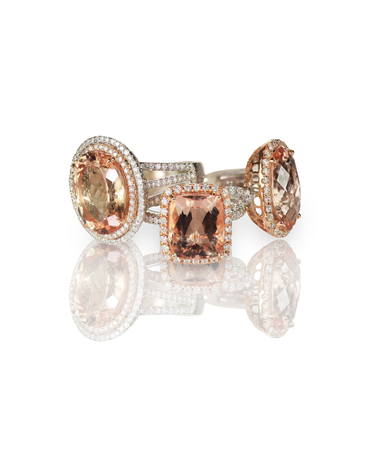 Cluster stack of diamond gemstone wedding engagment rings. Cushion Cut morganite pink stones with halo settings