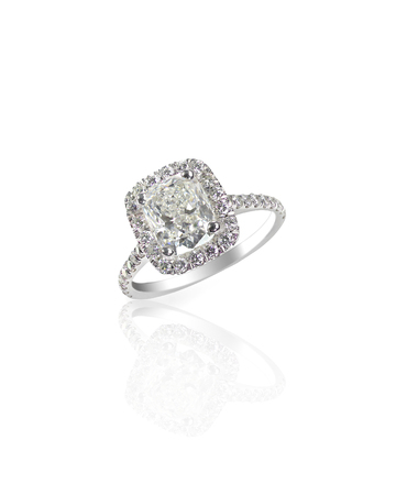 Huge giant cushion cut carat sparkling diamond wedding engagement ring isolated on white with a reflection
