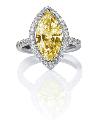 Fancy Yellow Citrine Topaz Beautiful Diamond Engagement ring. Gemstone Marquise cut surrounded by a halo of diamonds. Stock Photo