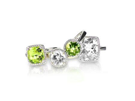 Set of green peridot diamond rings gemstone fine jewelry. Group stack or cluster of multiple gemstone diamond rings. 版權商用圖片