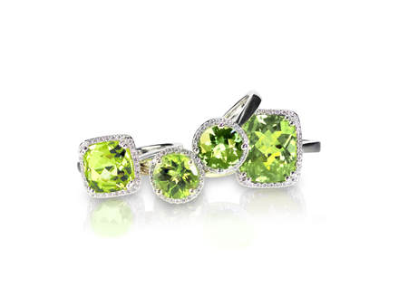 Set of green peridot diamond rings gemstone fine jewelry. Group stack or cluster of multiple gemstone diamond rings. Stock Photo