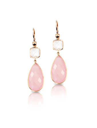 Pink rose quartz and crystal pear shaped drop earrings isolated on white with a reflection