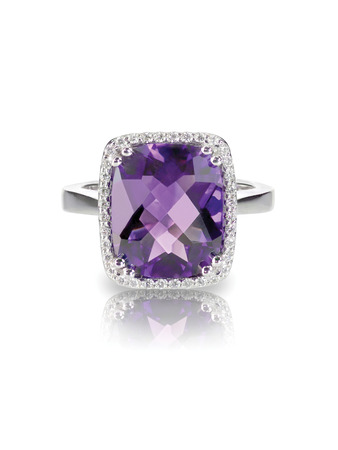 Large Rectangle purple amethyst cushion cut diamond halo fashion cocktail or engagement ring. isolated on white with a reflection
