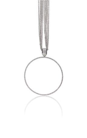 A beautiful diamond and gold pendant dangles from a chain. Fine Jewelry necklace isolated on a white background with shadow and reflection