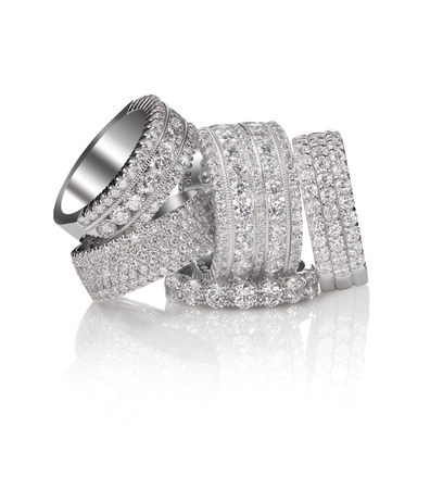 Set of diamond pave wedding band rings gemstone fine jewelry. Group stack or cluster of multiple gemstone diamond rings.