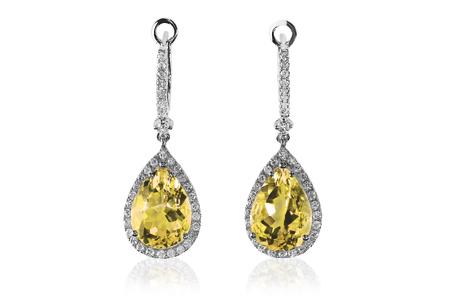 Beautiful Diamond gemstone yellow topaz citrine cushion cut pear shape teardrop drop dangle diamond earrings. 版權商用圖片