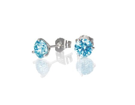 Blue diamond stud earrings topaz round brilliant isolated on white with a reflection