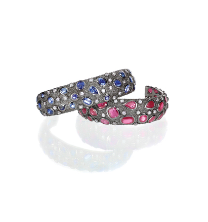 Two jeweled bangle bracelets with diamonds and gemstones of rubys and sapphires