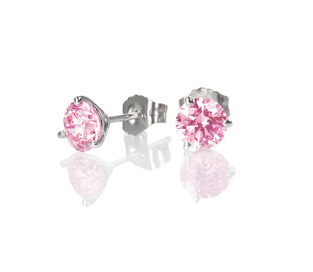 Pink diamond gemstone stud earrings isolated on white with a reflection