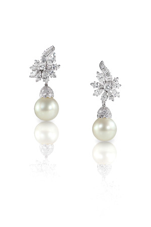Beautiful Diamond pearl Marquise drop dangle earrings studs pair isolated on white with a reflection Reklamní fotografie