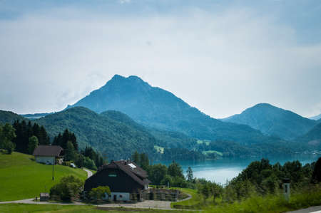 View of mountains, lake, and house in Austrian Lake District