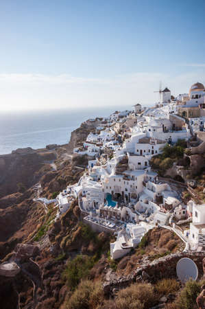 White building and surrounding cliffs of Oia Santorini, Greek Islands