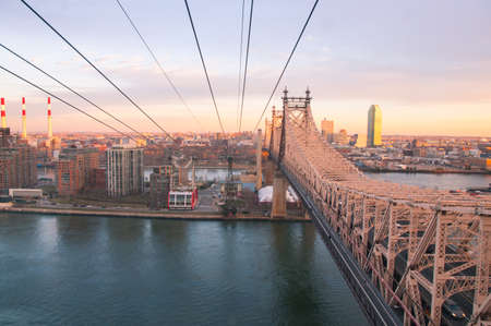 Roosevelt Island Tramway at sunset, from Manhattan to the island over the East River Editorial