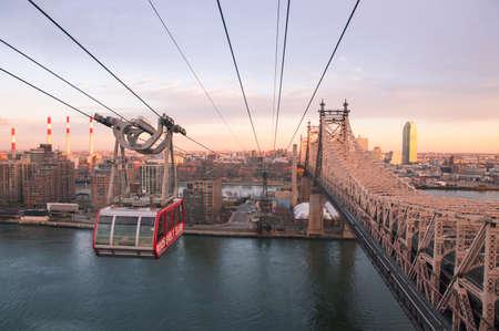 tramway: Roosevelt Island Tramway at sunset with gondola close-up