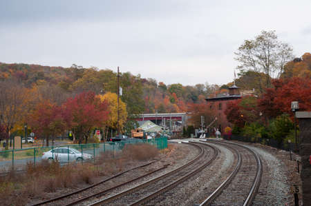 Train tracks with fall foliage in Westchester New York upstate Stock Photo