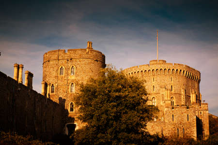 windsor: WINDSOR, circa 2017 - A golden hour establishing shot of the Windsor Castle in England, UK