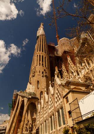 BARCELONA, circa 2015 - Ultra wide angle daytime shot of Gaudi La Sagrada Familia in Barcelona, Catalonia, Spain against a blue sky with volumetric clouds