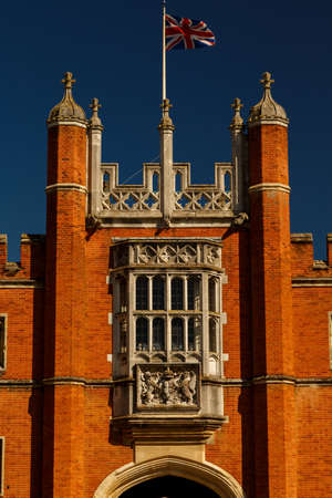 LONDON, circa 2016 - Closeup shot of the facade of the Hampton Court Palace with the Union Jack in London, England, UK