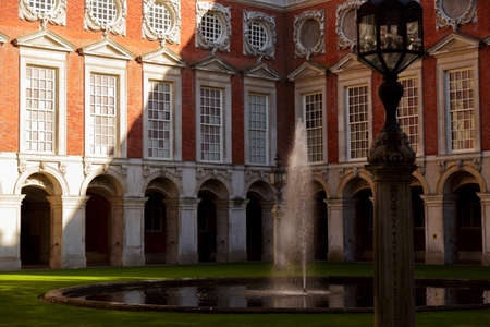 LONDON, circa 2016 - Telephoto shot of the inner fountain and facade of the Hampton Court Palace in London, England, UK Editorial