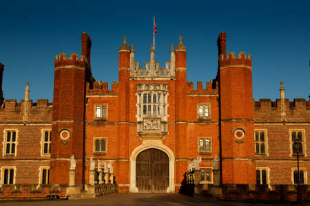 LONDON, circa 2016 - Medium shot of the facade of the Hampton Court Palace with the Union Jack in London, England, UK