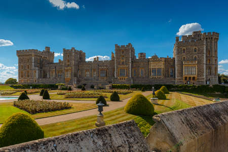 WINDSOR, September 2016 - A wide view of the medieval Windsor Castle and gardens bathed in glorious sunny weather