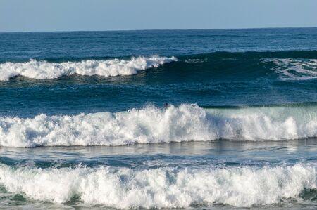 Sport surfing on the beach of zurriola located in san sebastian spain