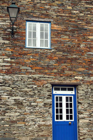 Blue door on an ancient stone house Stock Photo