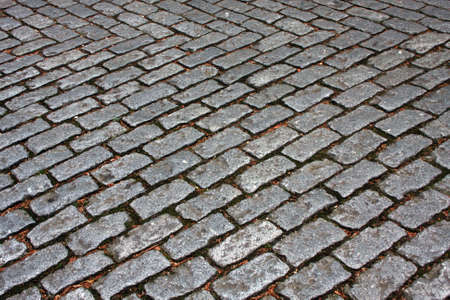 Old road made of rock tiles Stock Photo