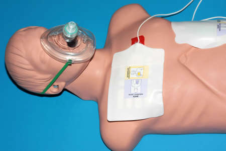 A dummy recieving CPR on a blue background.