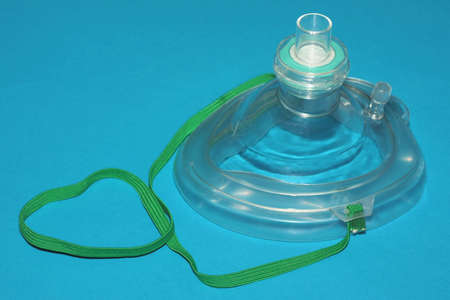 A CPR mask isolated on blue background.