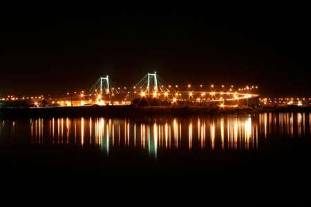 A portuguese bridge at night.