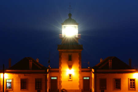 A lighthouse at night.