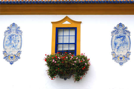 A detail of a window in an ancient house. Stock Photo