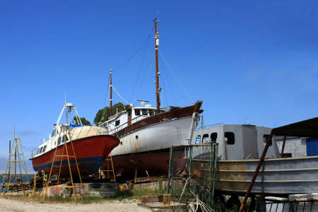 A detail of a shipyard with some old boats