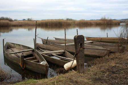 Some old wood boats on a lake shore Stock Photo