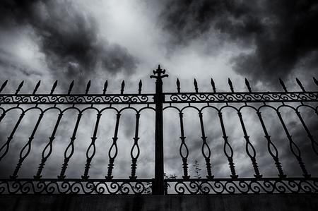 fear of failure: railing under the dark cloud Stock Photo