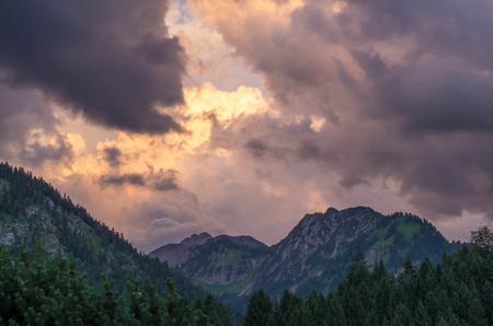 allgau: Stormy and dramatic clouds over the mountains near Oberstdorf, Allgau, Germany Stock Photo