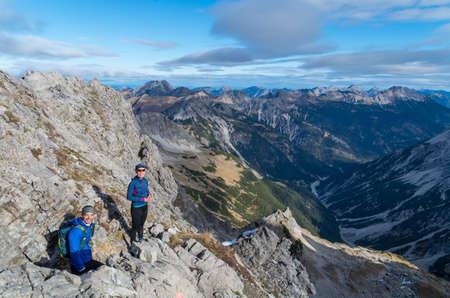 allgau: Man and woman mountaineering in Allgau Alps near Oberstdorf, Allgau, Germany
