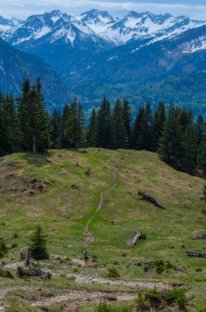 allgau: Female trailrunning in the mountains of Allgau near Oberstdorf, Oberallgau, Germany
