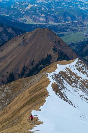 allgau: Man trailrunning in the mountains of Allgau near Oberstdorf, Oberallgau, Germany